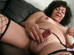 Good looking chocolate tranny Gina plays with her cock.