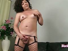 T-ebony Gina lets her hands wander all over her body.