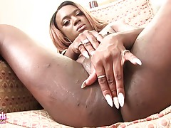 Chanel Cakes is a sexy black Grooby girl with a hot body, soft boobs, a great ass and a big hard cock! See this horny transgirl stroking her big hard cock!